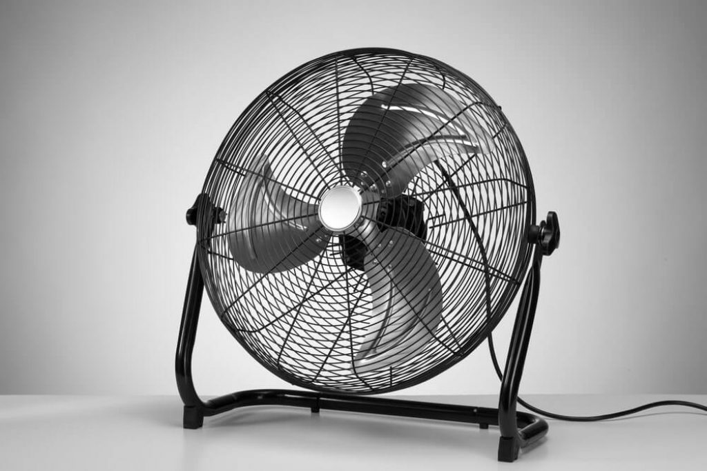 Black modern electric fan on white