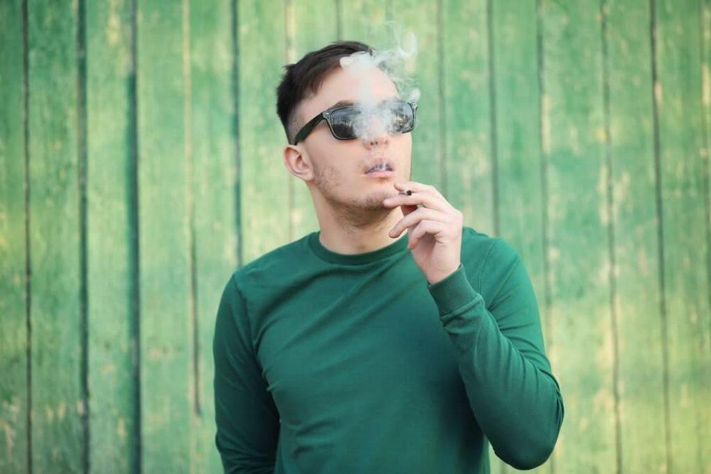 Handsome man smoking weed